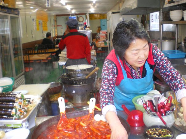 Street food in Busan - ddeokbokkie (spicy rice cake) and fried mandhu (pork or kimchi dumplings).