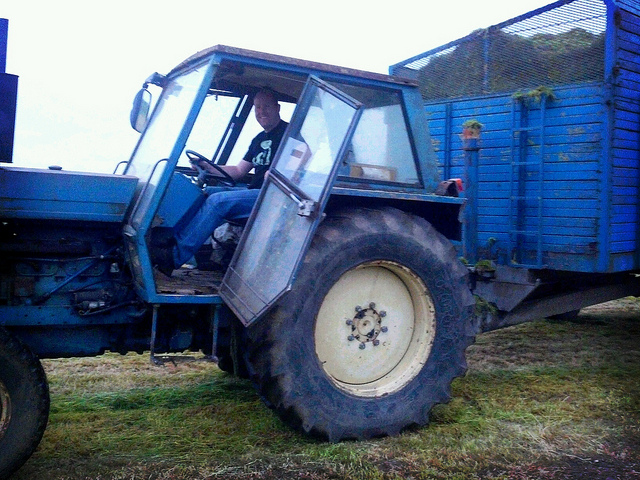Patrick hauls the silage over to the pit.
