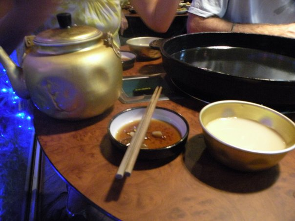 Waiting for our Kimchi Jeon (Kimchi pancake) to arrive we sip on Maekkoli (fermented rice alcohol, served chilled in a teapot, looks like milk).