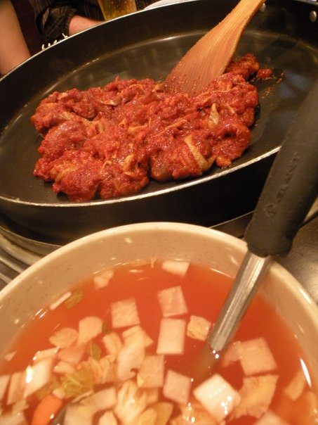 Dakgalbi in it's raw state, with a chilled radish soup on the side.