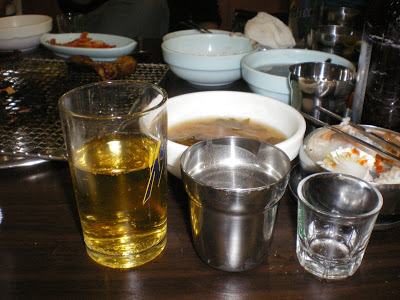 The necessary drinking glasses at any Korean BBQ establishment: beer, water & soju.